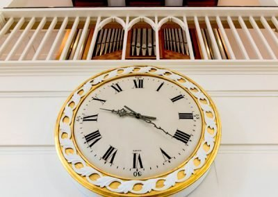 photo of clock and organ in sanctuary of AVC
