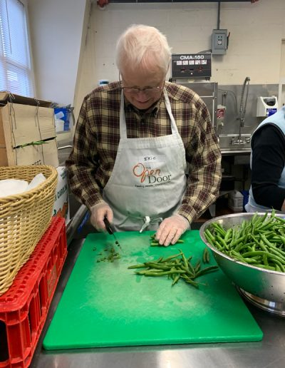 man-chopping-green-beans